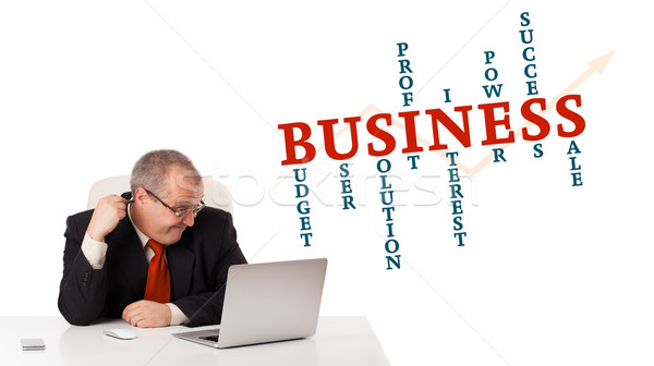 bisinessman sitting at desk and looking laptop with business word cloud, isolated on white Stock photo © ra2studio