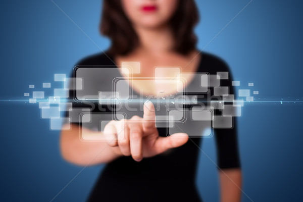 Businesswoman pressing high tech type of modern buttons Stock photo © ra2studio
