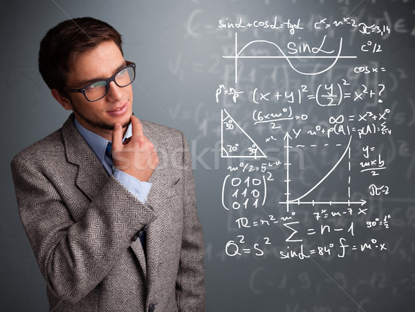 Handsome school boy thinking about complex mathematical signs Stock photo © ra2studio