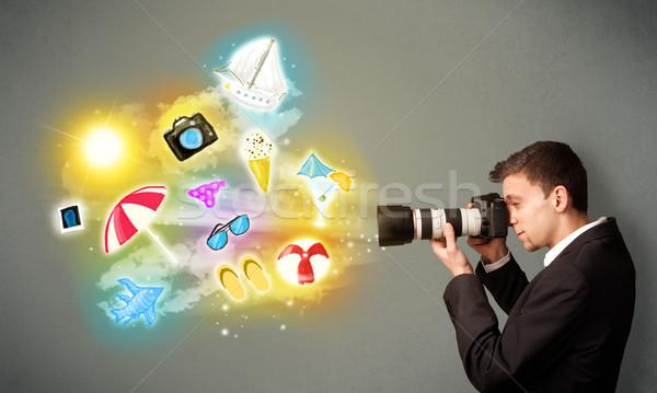 Teenage photographer making photos of holiday painted icons Stock photo © ra2studio