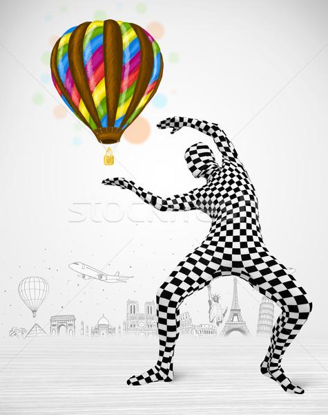 man in full body suit holding balloon Stock photo © ra2studio