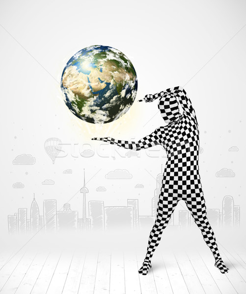 man in full body suit holding planet earth Stock photo © ra2studio