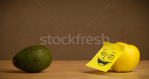 Apple with post-it note smiling at avocado Stock photo © ra2studio