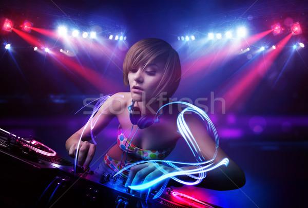 Diskjokey kız oynama müzik ışık Stok fotoğraf © ra2studio