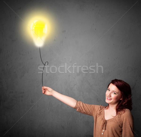 Mujer bombilla globo nina Foto stock © ra2studio