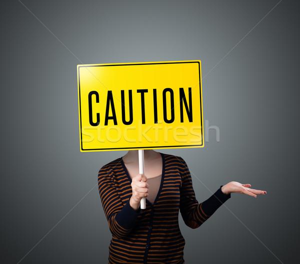 Jonge vrouw voorzichtigheid teken jonge dame Stockfoto © ra2studio