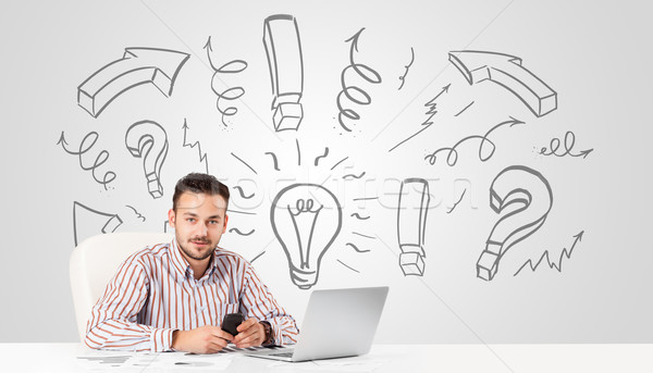 Young businessman brainstorming with drawn arrows and symbols Stock photo © ra2studio