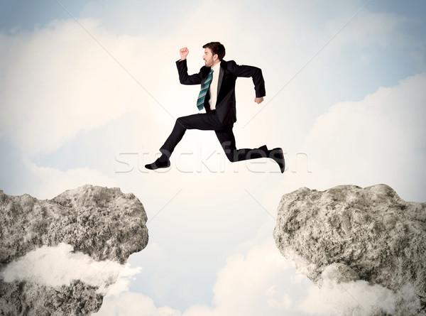 счастливым деловой человек прыжки утес человека горные Сток-фото © ra2studio