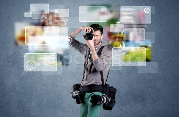 Bonito fotógrafo câmera jovem profissional masculino Foto stock © ra2studio