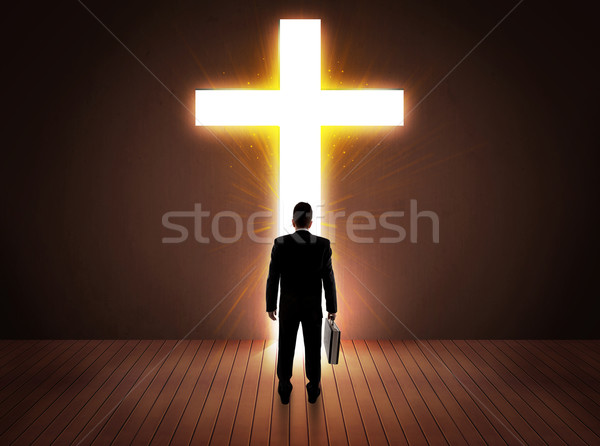 Uomo guardando luminoso cross segno famiglia Foto d'archivio © ra2studio