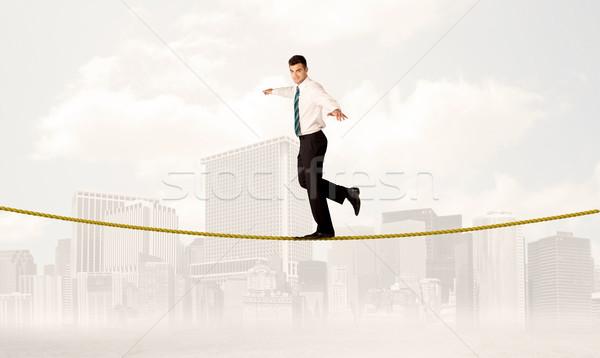 Uomo d'affari bilanciamento corda giovani elegante Foto d'archivio © ra2studio