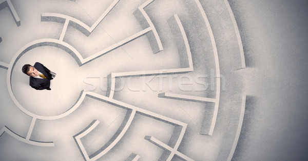 Business man trapped in a circular maze Stock photo © ra2studio