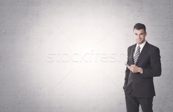 Elegante zakenman jonge verkoop pak Stockfoto © ra2studio
