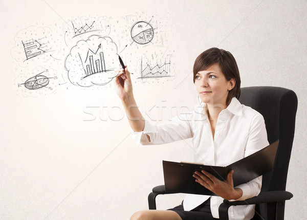 Young lady sketching financial chart icons and symbols Stock photo © ra2studio