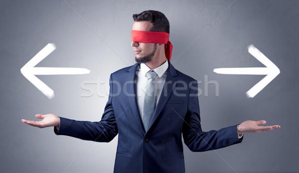 Pokryty oka biznesmen kierunku dwa Zdjęcia stock © ra2studio