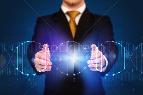 üzletember tart DNS kezek kéz férfi Stock fotó © ra2studio