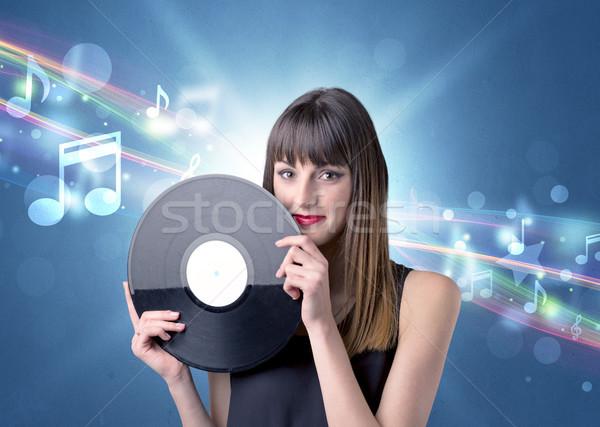 Dame vinyl record jonge Blauw Stockfoto © ra2studio