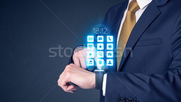 Businessman wearing smartwatch. Stock photo © ra2studio