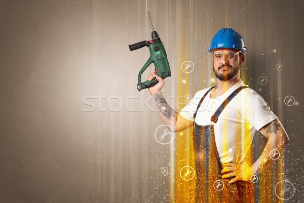 Manuale lavoratore chiave simbolo simboli strumento Foto d'archivio © ra2studio