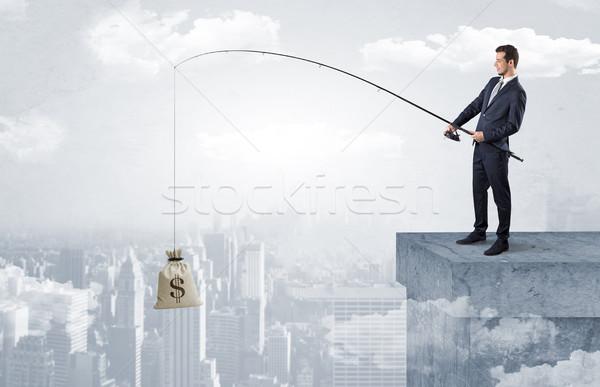 Stock fotó: üzletember · halászat · valuta · város · zsák · hal