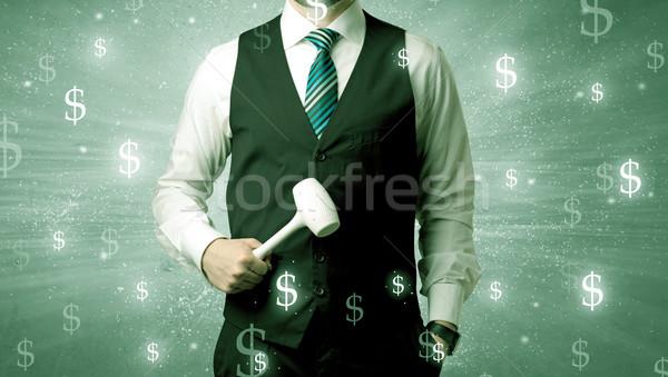 Businassman standing with tool on his hand. Stock photo © ra2studio