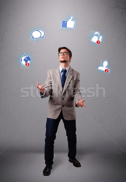 Jóképű fiatal srác zsonglőrködés közösségi média ikonok fiú Stock fotó © ra2studio