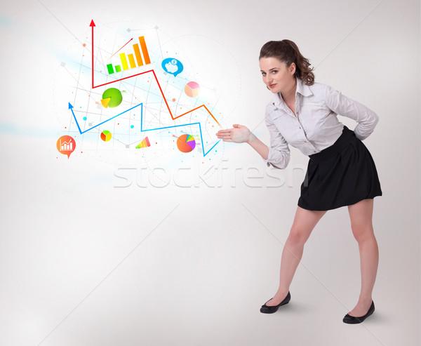 Genç iş kadını renkli diyagramları Stok fotoğraf © ra2studio