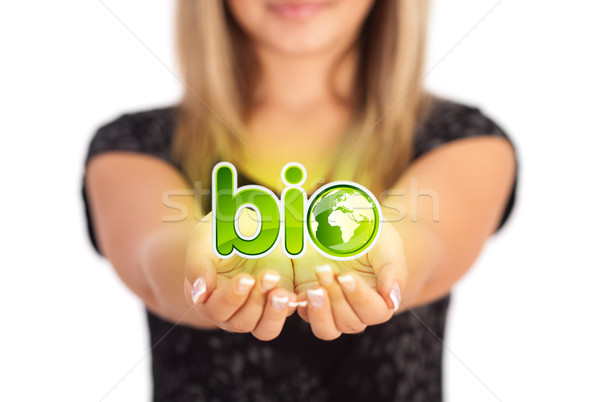 Stock photo: Woman hands holding ECO sign