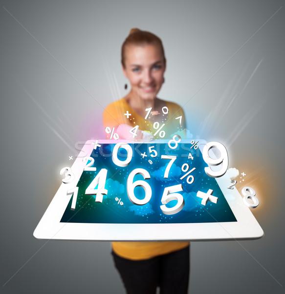 Stockfoto: Jonge · vrouw · tablet · nummers · mooie · vrouw
