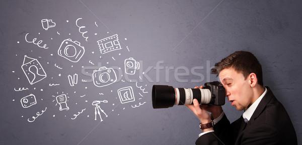 Young photographer shooting photography icons Stock photo © ra2studio