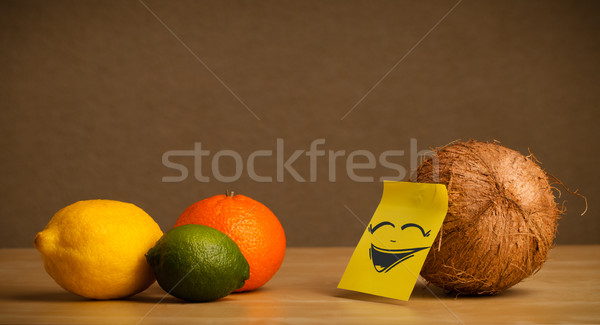 Coconut with post-it note laughing on citrus fruits Stock photo © ra2studio