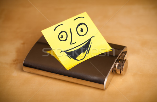 Post-it note with smiley face sticked on a hip flask Stock photo © ra2studio