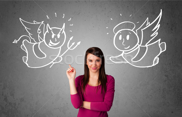 Woman standing between the angel and the devil Stock photo © ra2studio