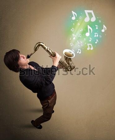 красивый музыканта играет саксофон музыки отмечает молодые Сток-фото © ra2studio