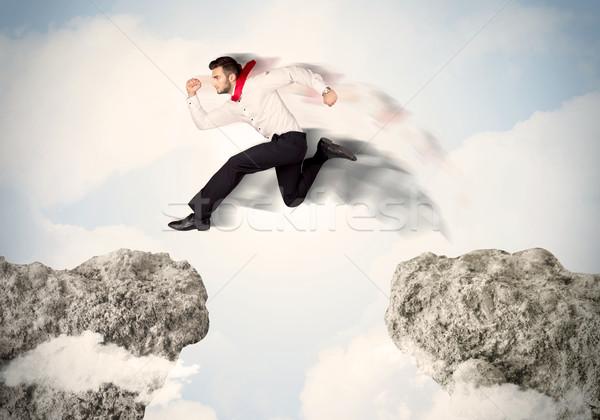 Feliz hombre de negocios saltar acantilado negocios hombre Foto stock © ra2studio