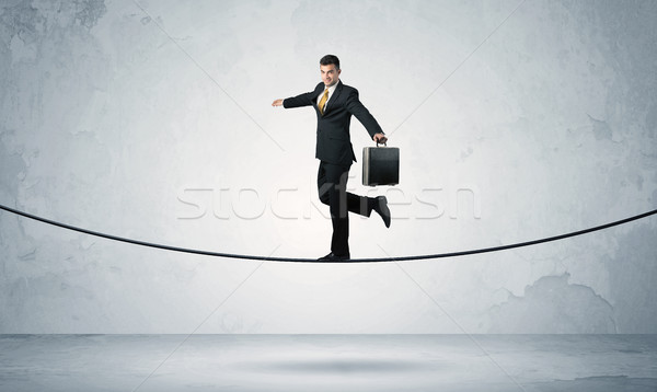Sales guy balancing on tight rope Stock photo © ra2studio