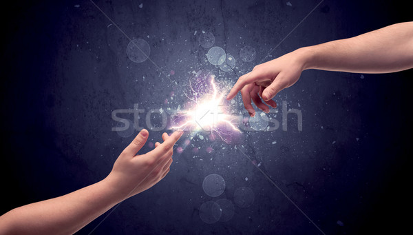 Mãos luz faísca dois masculino outro Foto stock © ra2studio