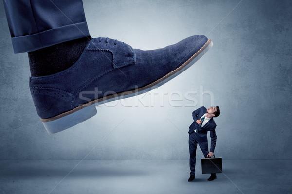 Cruel boss tramping his employee Stock photo © ra2studio