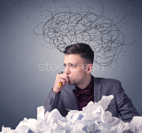 Businessman above crumpled paper Stock photo © ra2studio
