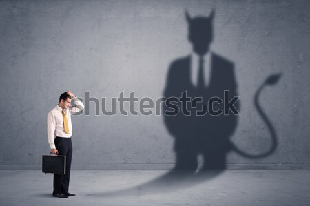 Business man looking at his own devil demon shadow concept Stock photo © ra2studio