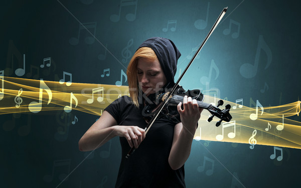 Musician playing on violin with notes around Stock photo © ra2studio