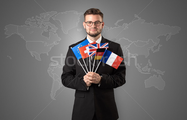 Stock photo: Man standing with flag and map background