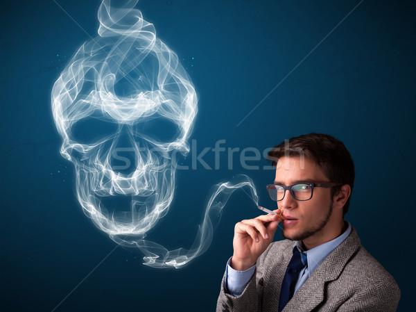 молодым человеком курение опасный сигарету токсичный череп Сток-фото © ra2studio