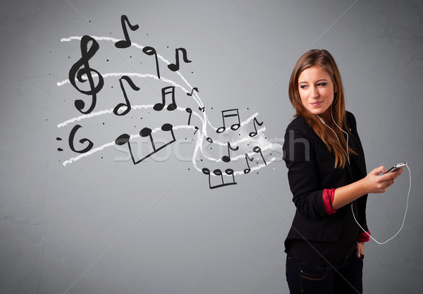 attractive young lady singing and listening to music with musical notes Stock photo © ra2studio