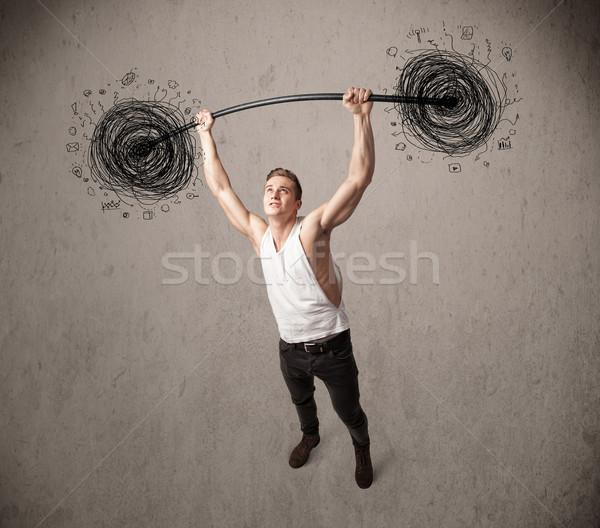 Izmos férfi emel káosz erős kéz Stock fotó © ra2studio