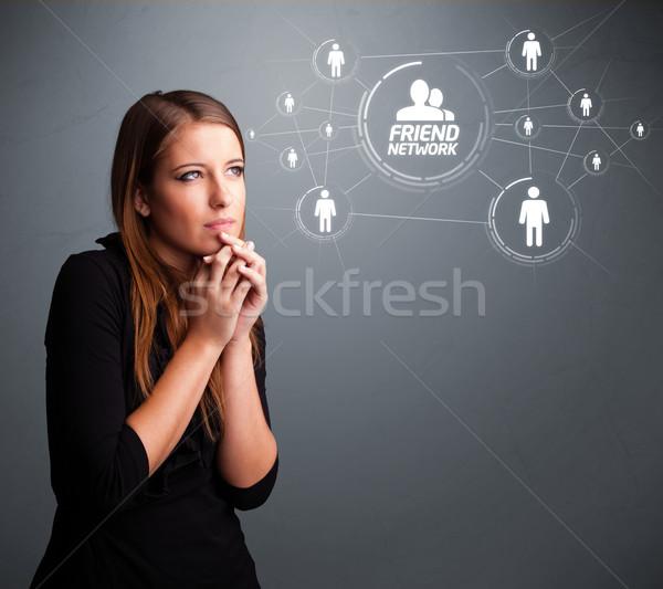 привлекательная девушка глядя современных привлекательный Сток-фото © ra2studio