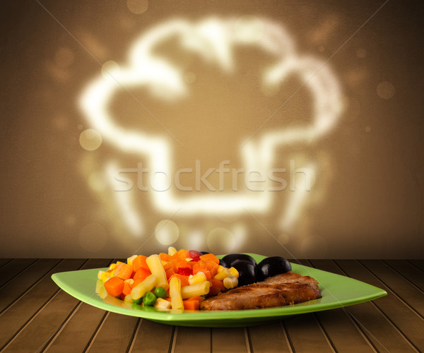 Delicious food plate with chef cook hat Stock photo © ra2studio
