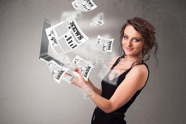 Casual young woman holdin notebook and reading the explosive new Stock photo © ra2studio
