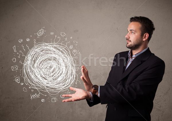 Chaos concept in the hand of a businessman Stock photo © ra2studio