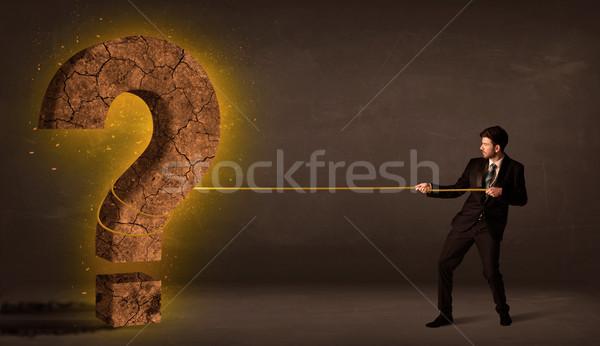 Homem de negócios grande sólido ponto de interrogação pedra Foto stock © ra2studio